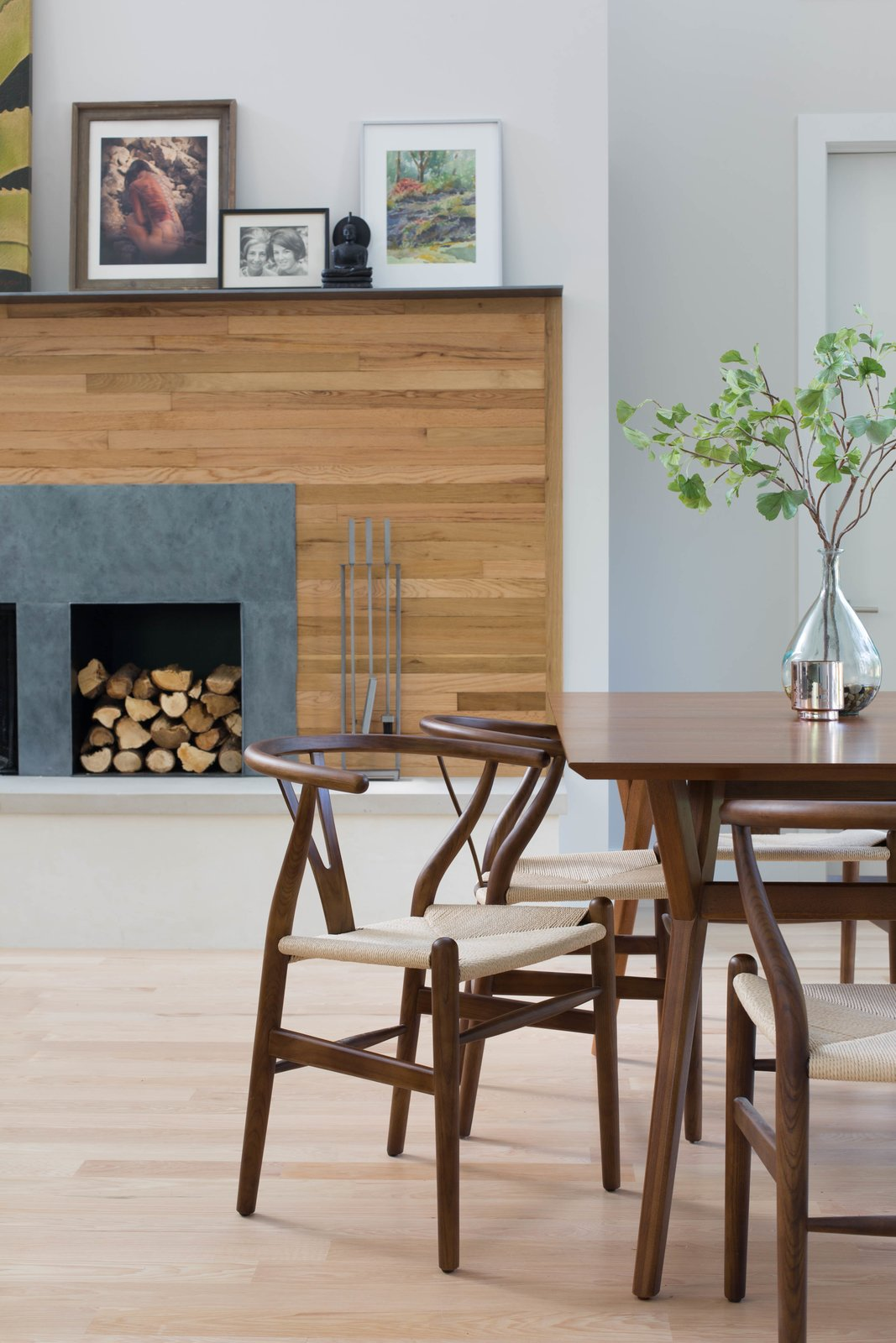 The wood used on the fireplace wall was salvaged from the floor of the old home that the Architect and her husband lived in before eventually deciding to build a new home in its place. It was painstakingly salvaged, sorted, stripped, cut, and re-stained before finding new life as a wall finish.