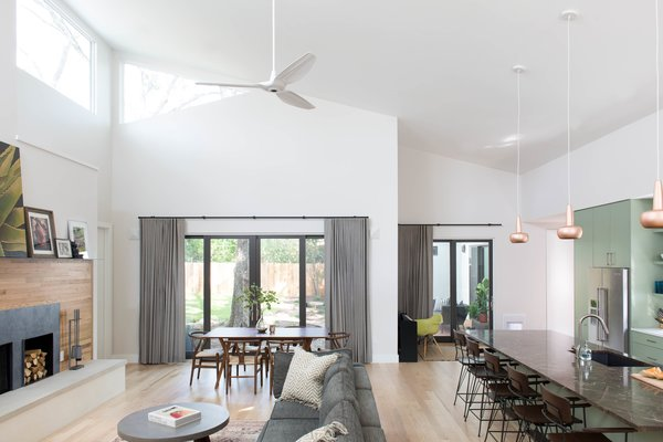 The open concept Living/Dining/Kitchen has a large vaulted ceiling with rectangular and triangular clerestory windows that wash the space in natural light from high above. Lights are hardly ever turned on during the day, since there is ample natural light in the daytime.