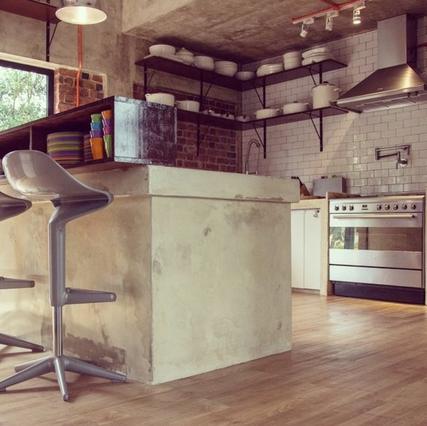 Concrete counter top and openness of the kitchen make social gatherings more relax and homely Photo 6 of Plantation House modern home