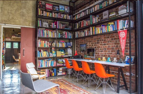 The study with floor to ceiling book shelves double up as internet browsing area and home tuition Photo 8 of Plantation House modern home