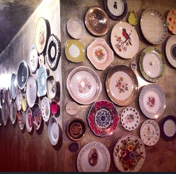 The wall of plates at the TV room is growing in numbers Photo 9 of Plantation House modern home