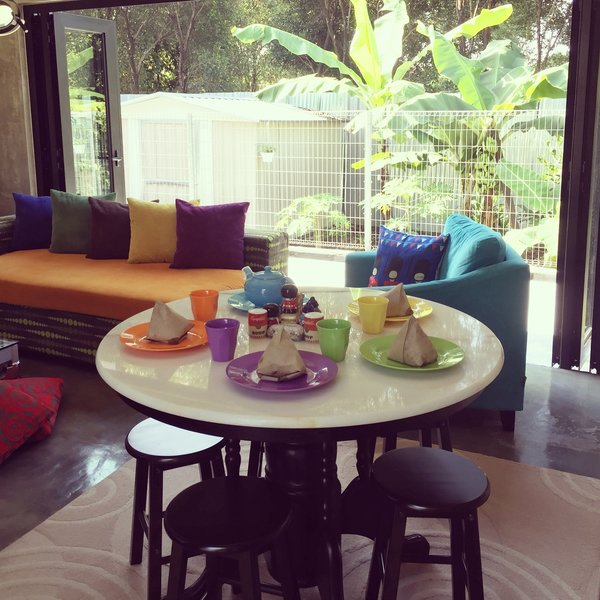 The round table in the TV room provides comfort for eating while watching what is on the tube Photo 10 of Plantation House modern home