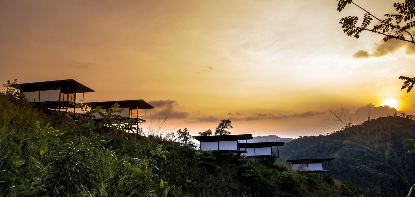 Individual rooms perched on stilts overlooking the valley  Santani Wellness Resort and Spa by vickum