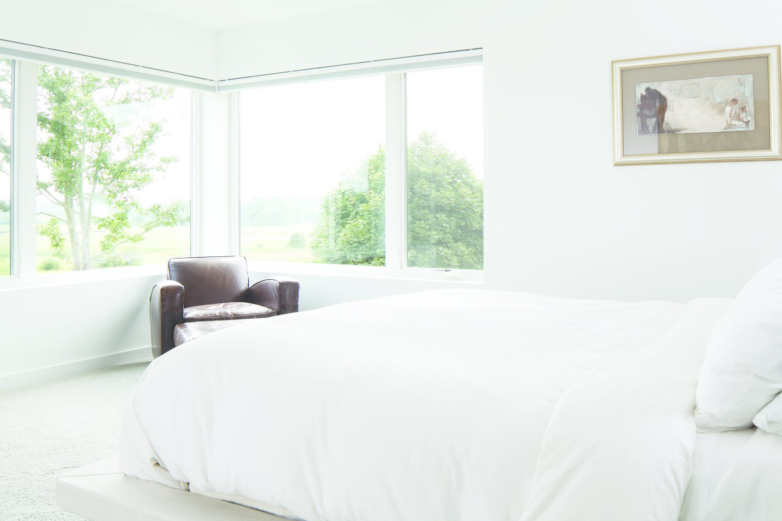 White Bedroom - where the view is the accent wall  Modern On The Marsh by Kevin