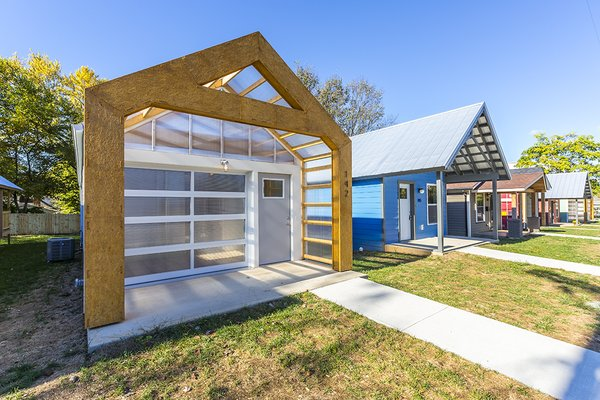 Front Porch with Roll-up Door Photo  of York Street Maker Spaces modern home