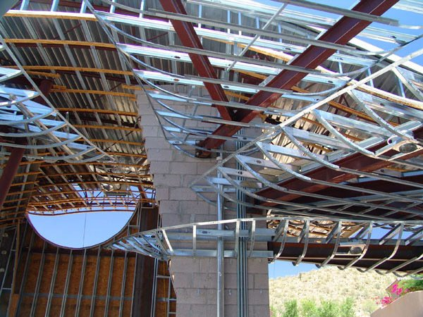 Steel frame & light metal framing soon to be wrapped with lath and plaster for a beautiful smooth finish. Spaces between have translucent honeycomb poly-carbonate to allow light and be easy and cost effective for construction. Photo 12 of Scottsdale Desert Home modern home