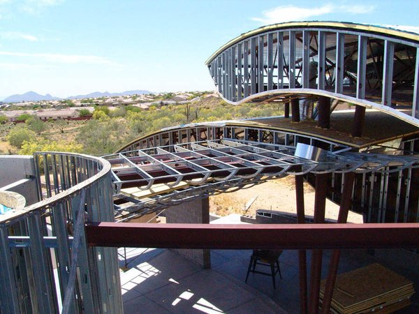 By using long span steel beams and open web bar joists, we were able to create dramatic wide open spaces that have multiple stepped levels to allow indirect light. Photo 11 of Scottsdale Desert Home modern home