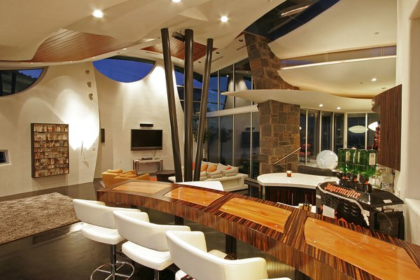 The triple steel pipe holds up most of the multilayered rooves overhead. Photo 15 of Scottsdale Desert Home modern home