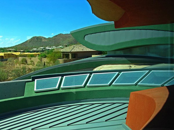 Skylights surround the concentric walls forming dining room & stairs, beautiful orange & green stucco inspired from the many desert flowers of similar hue. Photo 20 of Scottsdale Desert Home modern home