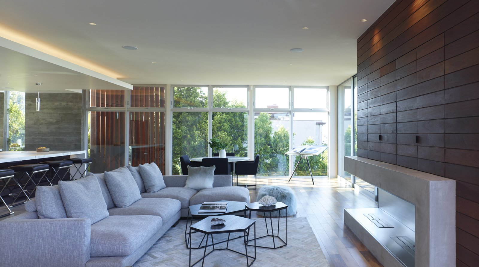 Open plan living room, leading to kitchen and decks. Tagged: Living, Coffee Tables, Sectional, Chair, Ceiling, Accent, Recessed, Dark Hardwood, and Gas Burning.  Best Living Ceiling Gas Burning Photos from Stradella Residence