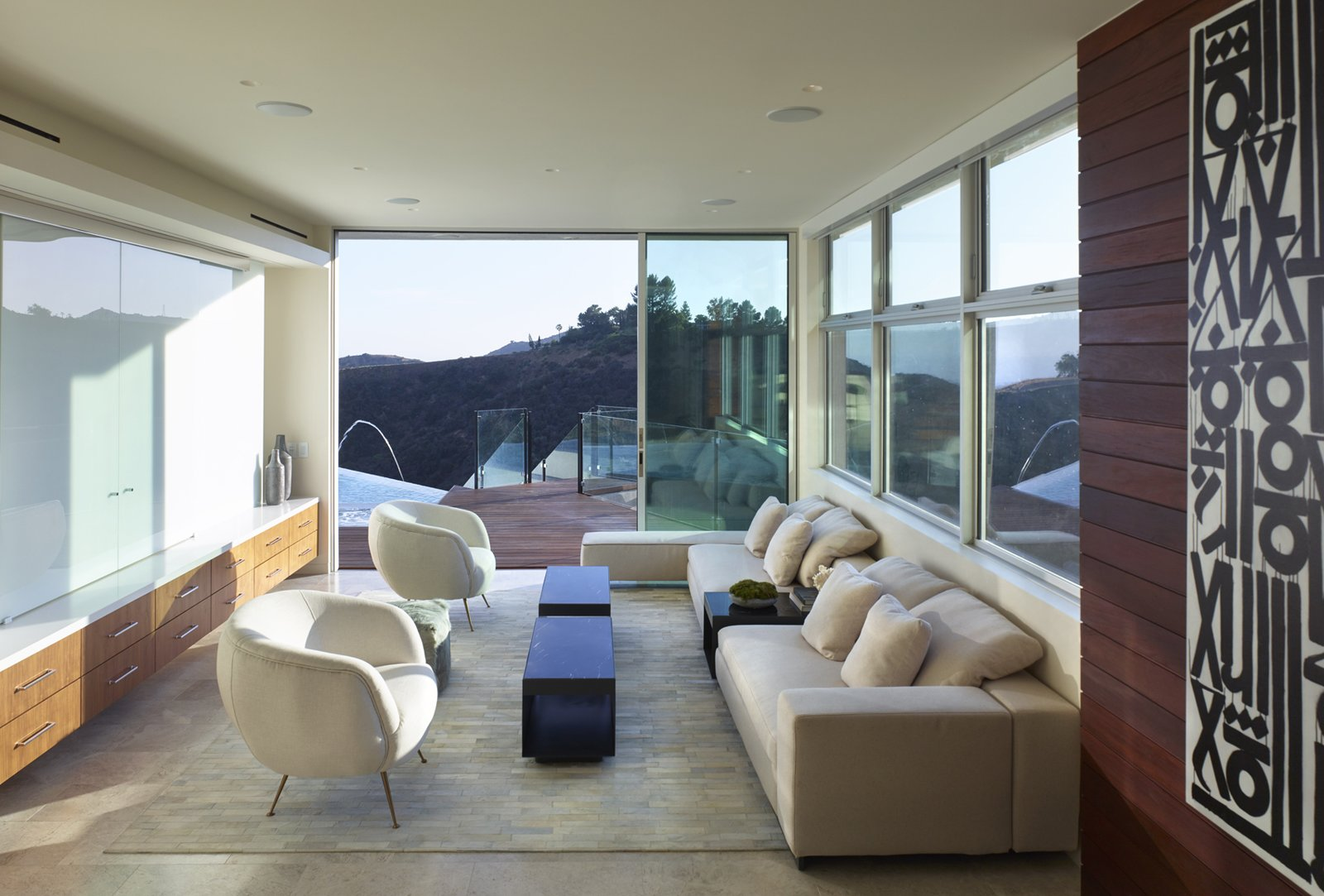 Lower level lounge, leading to pool and canyon views. Tagged: Living, Chair, Sofa, Bench, End Tables, Sectional, Coffee Tables, Ceiling, Travertine, Recessed, and Accent.  Best Living Bench Sectional Photos from Stradella Residence