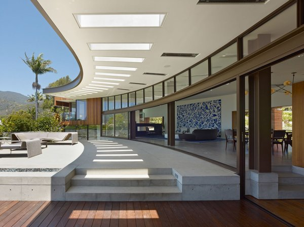 The courtyard side of the house is an exercise in transparency. Sliding glass panels open up the entire house to the outdoors. Photo 5 of Ziering Residence modern home