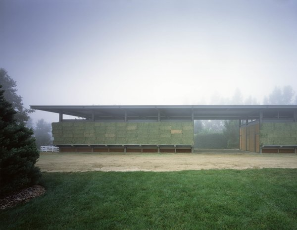 The concept is based on the ever-changing color and positioning of the hay as cladding on the barn. When hay is stacked along the outer storage shelves in the winter, it is green; as the season unfolds, the hay turns yellow, and the caretaker removes it from the shelves as it is used for feed. Photo  of Somis Hay Barn modern home