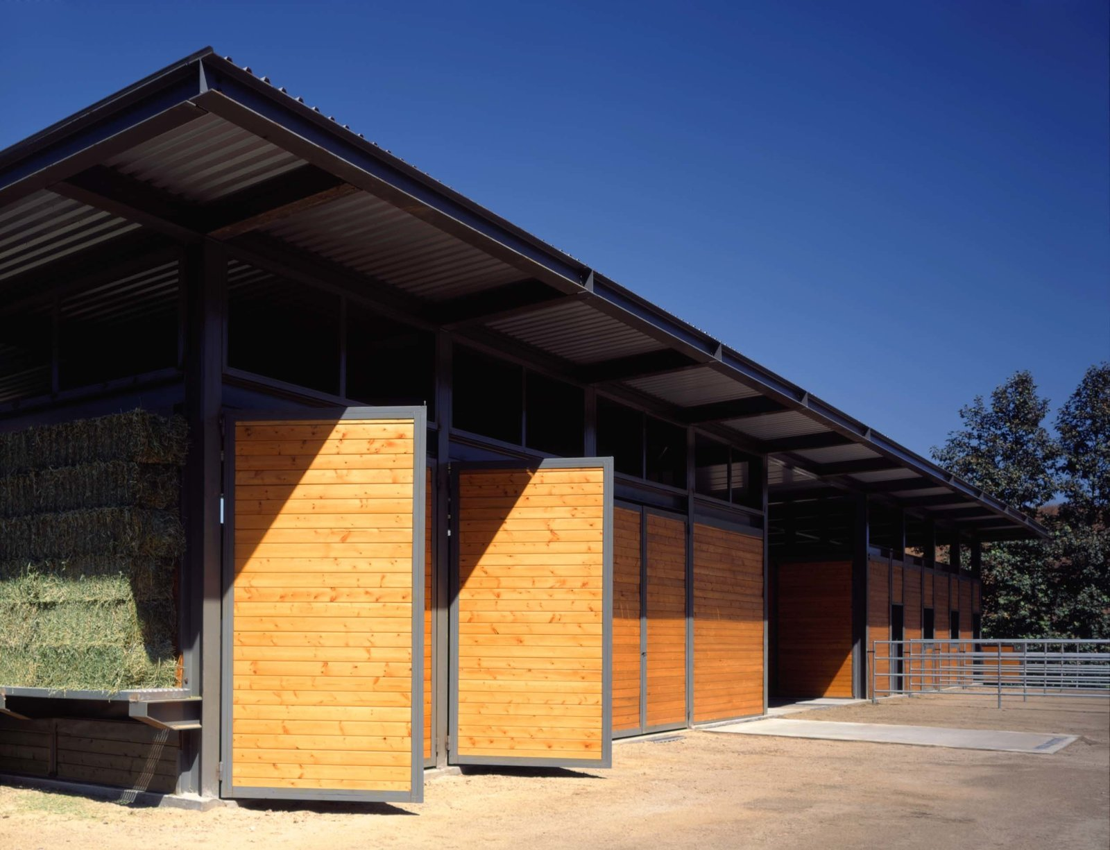 The barn itself can house four horses, tractors, tack room, and other farm equipment needed for maintaining the forty acre lemon grove that surrounds it.  Somis Hay Barn by Studio Pali Fekete architects