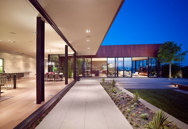 The exterior Parklex provide a warm tone against the natural elements surrounding the residence. Photo 2 of Nightingale Residence modern home