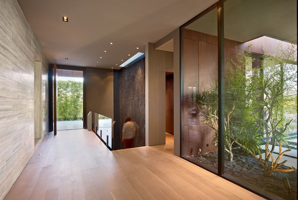 Interior materials include a diverse selection of wood and stone that was custom tailored to the owner's requirements. Photo 4 of Nightingale Residence modern home