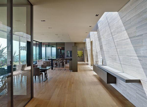 Several rectangular skylights throughout the home contribute to balancing the light within the main living spaces. Photo 6 of Nightingale Residence modern home