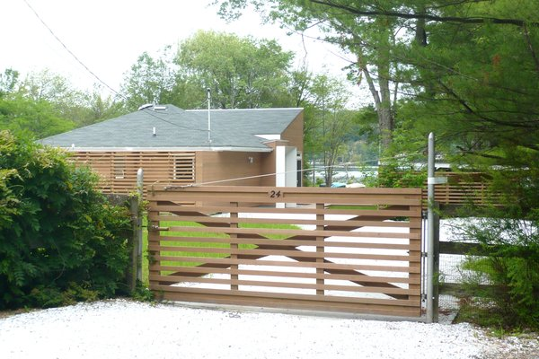 Road side entry Photo 5 of Jureller Lake House modern home