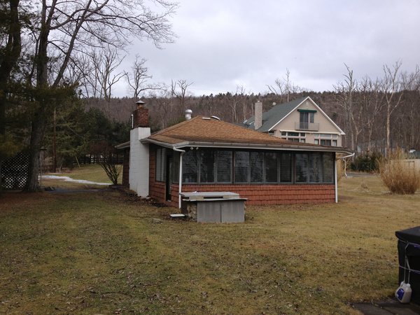 Structure before renovation. Photo 8 of Jureller Lake House modern home