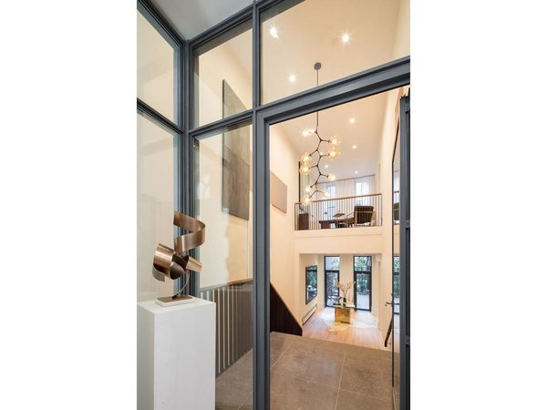 Entryway with custom art by Interior Marketing Group Photo  of Greenwich Village Townhouse modern home