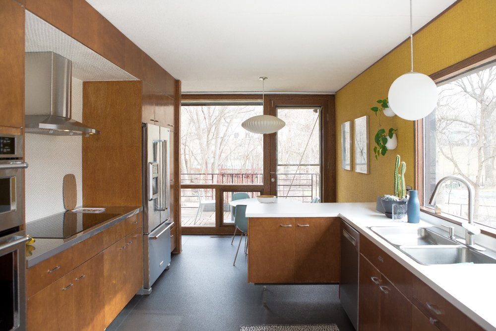 Kitchen with lovingly restored, original cabinets.  The Soulek House by Jen Stack