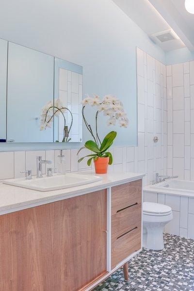 Modern home with bath room, ceramic tile floor, pendant lighting, drop in sink, subway tile wall, and one piece toilet. Terra Linda bathroom remodel Photo  of Terra Linda Bathroom Remodel