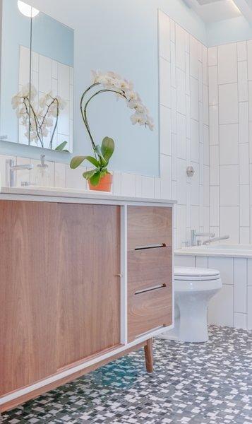Modern home with bath room, ceramic tile floor, drop in sink, pendant lighting, one piece toilet, and subway tile wall. Terra Linda bathroom remodel Photo 4 of Terra Linda Bathroom Remodel
