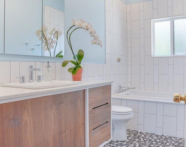Modern home with bath room, one piece toilet, subway tile wall, pendant lighting, drop in sink, and ceramic tile floor. Terra Linda bathroom remodel Photo 3 of Terra Linda Bathroom Remodel