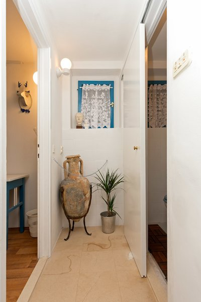Bathroom sliding door on the right. Bedroom left. Photo 10 of Shabby Chic Beach Cottage modern home