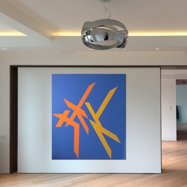 Sliding art wall with a walnut surround. Photo  of At Home With Art modern home