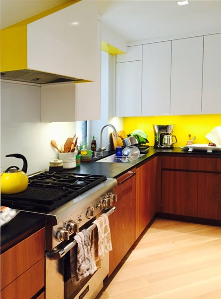 Yellow, white, walnut kitchen Photo 3 of At Home With Art modern home
