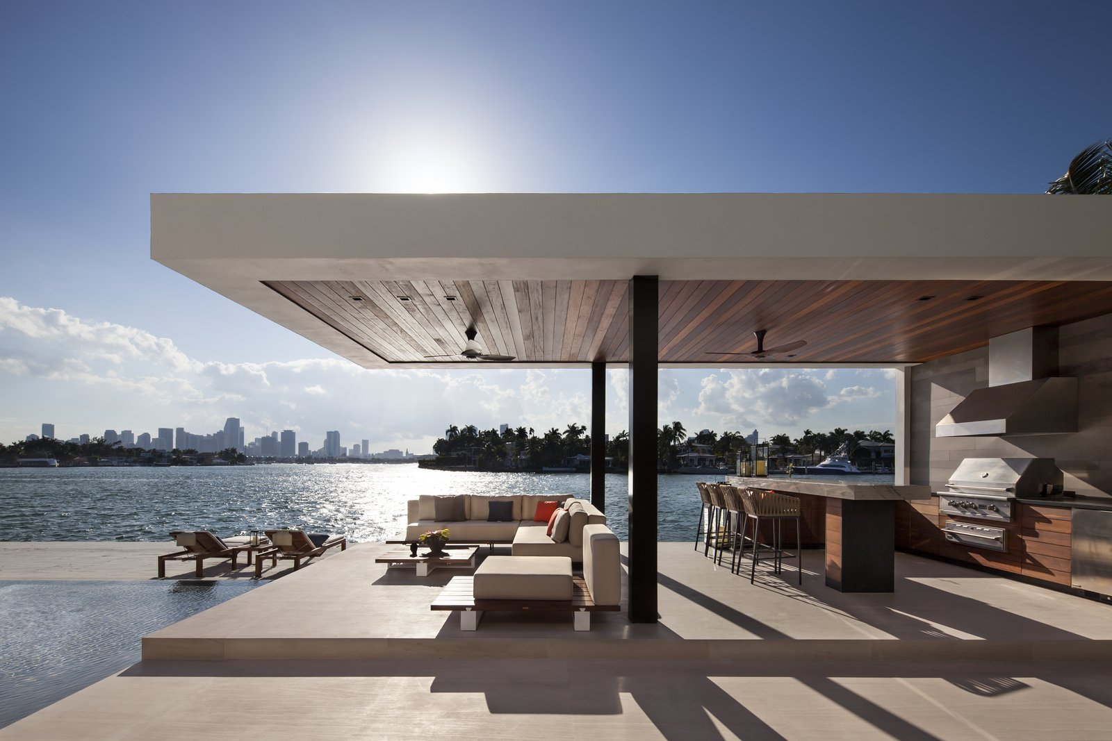 Outdoor kitchen featuring a cantilevered cabana   Casa Clara by Choeff Levy Fischman
