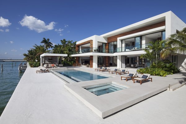 Rear exterior with pool, hot tub, and private white sand beach Photo 4 of Casa Clara modern home