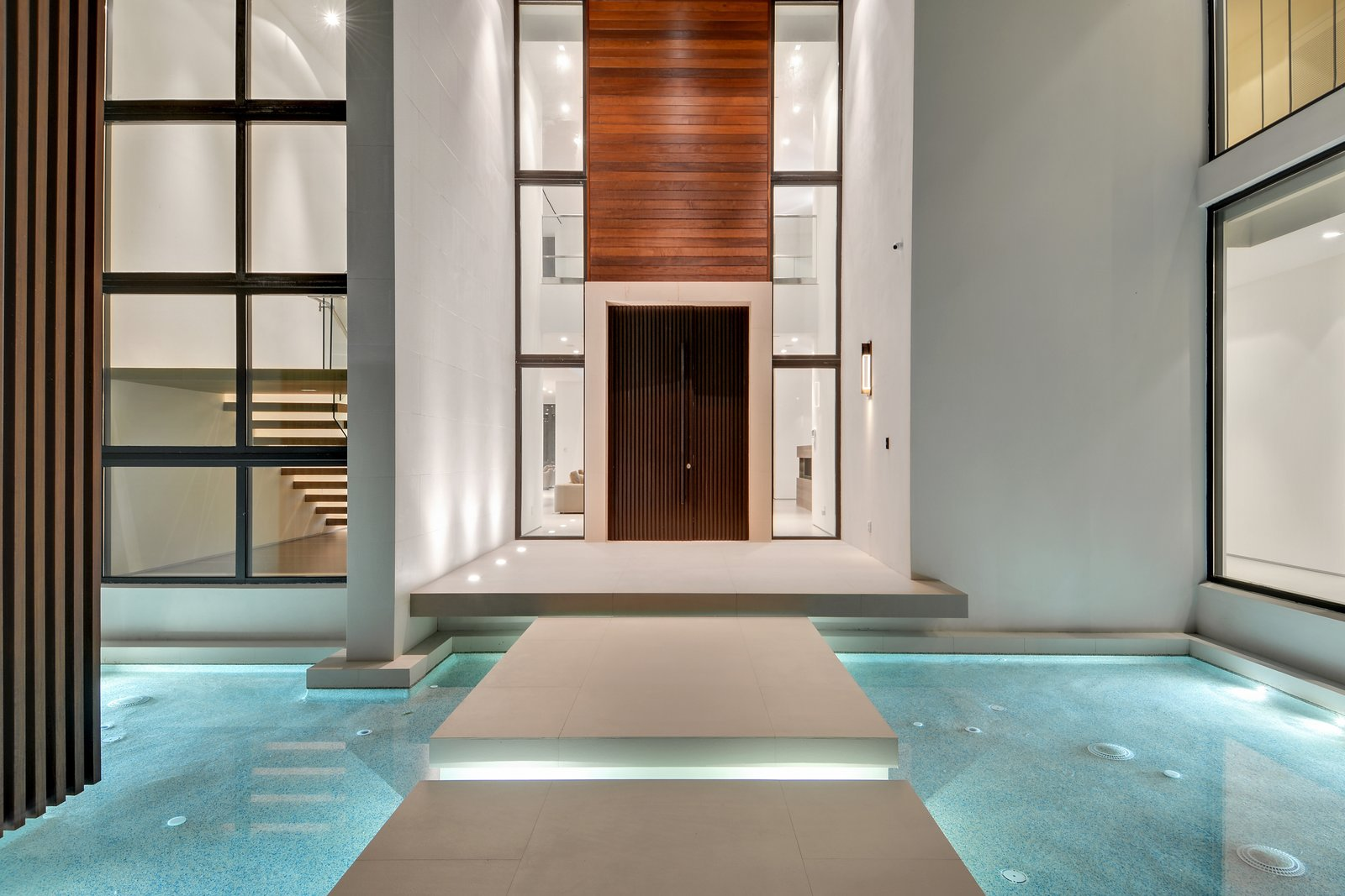 Residence front entrance with floating stepping stones and reflecting pond  Allison Road Residence by Choeff Levy Fischman