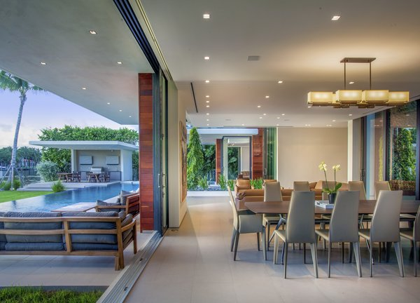Indoor-outdoor living and dining area Photo 2 of Allison Road Residence modern home