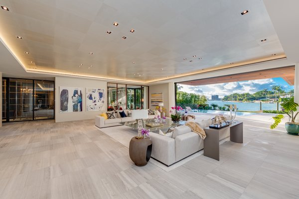 The home's living room is spans 40 feet wide. Photo 5 of North Bay Road Residence modern home