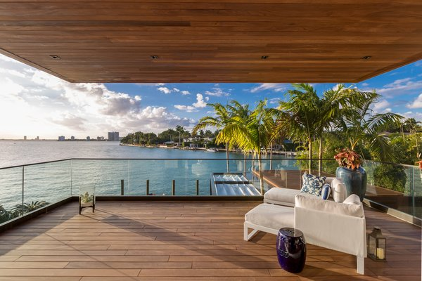 A second master bedroom comes with spacious private balcony and bay views. Photo 12 of North Bay Road Residence modern home