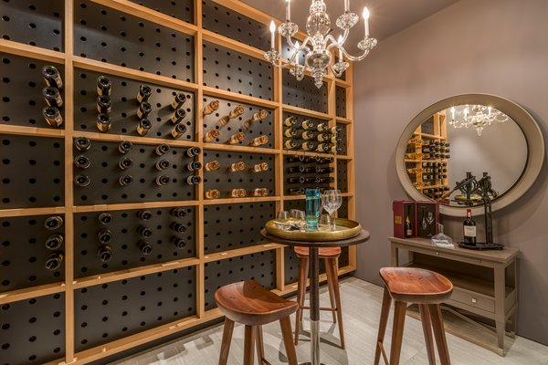 The residence's wine cellar holds more than 600 bottles of wine. Photo 17 of North Bay Road Residence modern home
