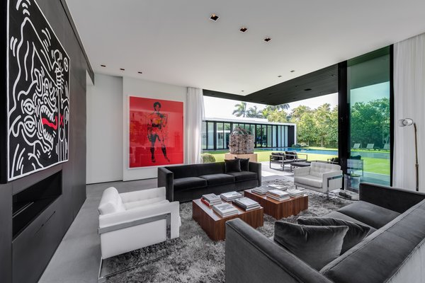 Large artwork hangs in the home's living room, which opens up to the backyard. Photo 2 of Ponce Davis Residence modern home