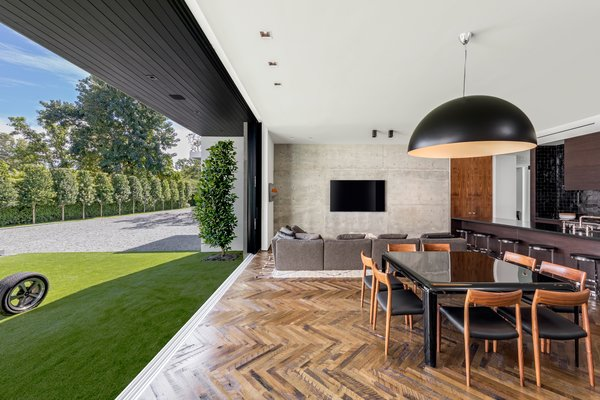 The kitchen and informal dining area opens up to a yard.  Photo 5 of Ponce Davis Residence modern home