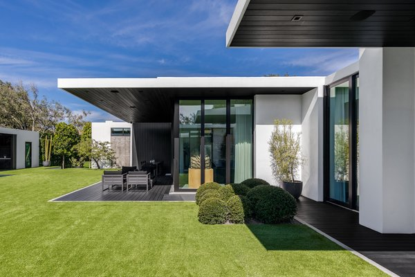 Each room was designed to include a connecting outdoor patio complete with a cantilevered overhang for full shade. Photo 8 of Ponce Davis Residence modern home