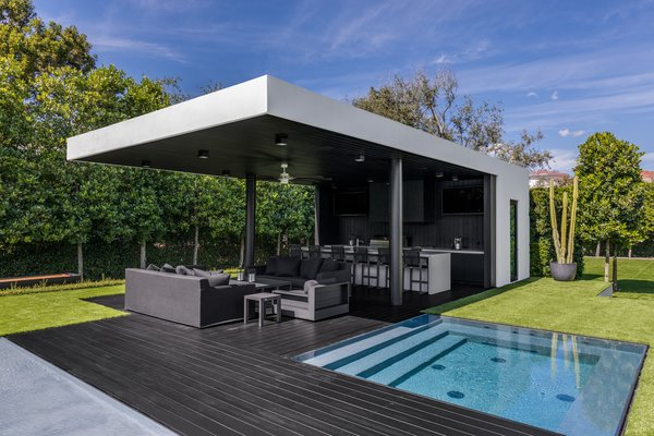 The outdoor cabana is located next to an underground hot tub.  Photo 12 of Ponce Davis Residence modern home