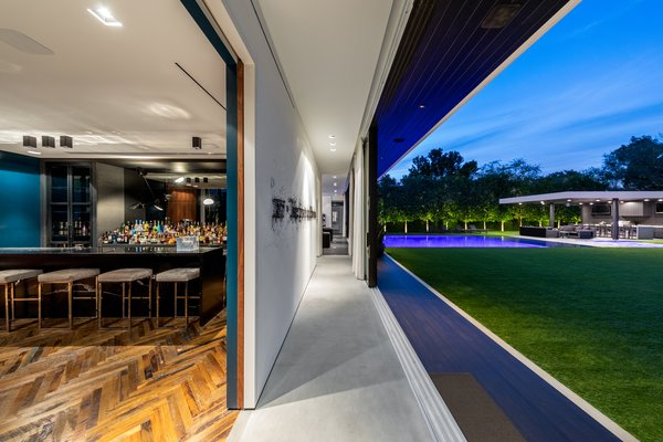 Every room in the house opens up to the outdoors creating a seamless indoor-outdoor environment. Photo 13 of Ponce Davis Residence modern home