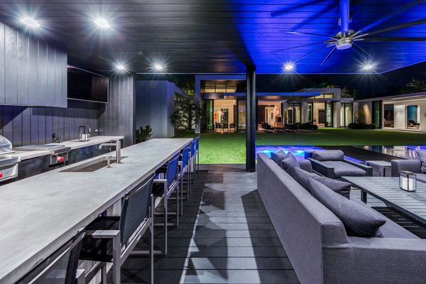 The outdoor kitchen and cabana is the perfect location for entertaining. Photo 14 of Ponce Davis Residence modern home