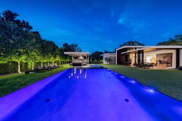 The backyard at twilight.  Photo 16 of Ponce Davis Residence modern home