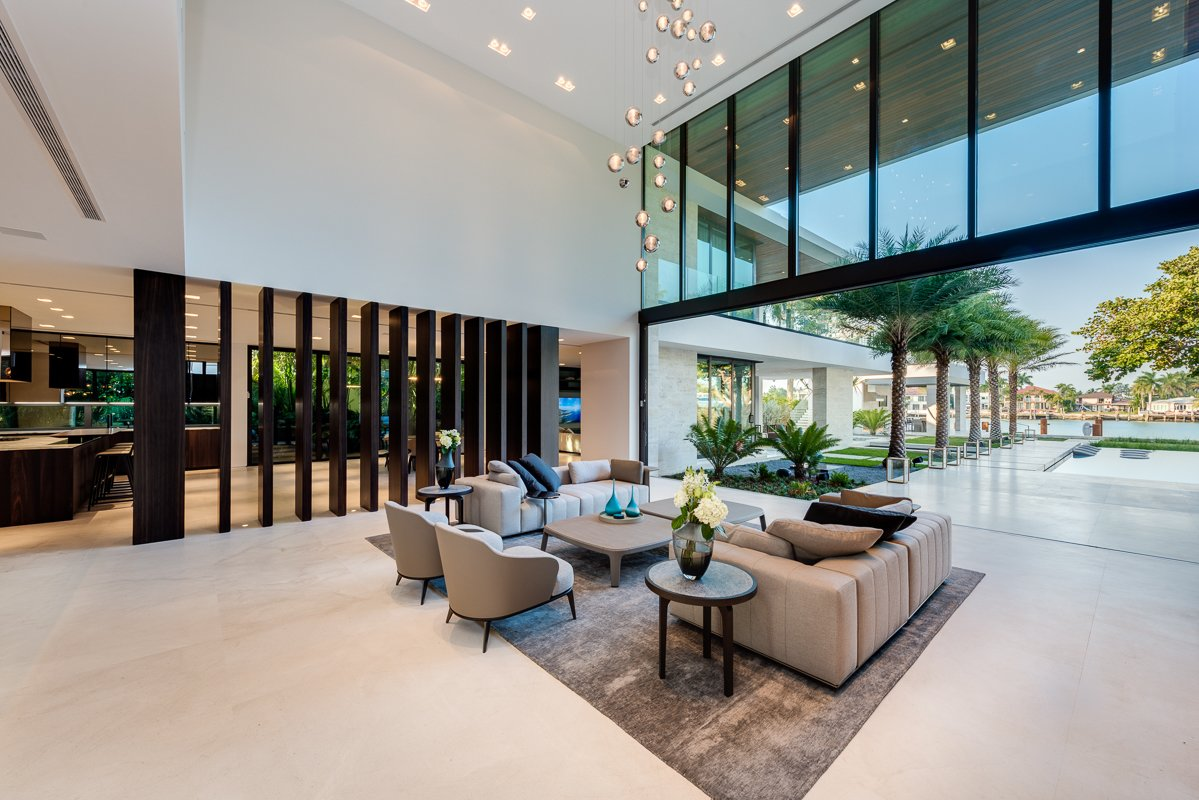 Vertical wood elements separate the main living room from the kitchen area, while still emphasizing openness. Tagged: Living, Sofa, End Tables, Coffee Tables, Chair, Ceiling, Recessed, Ribbon, and Limestone.  Best Living Ribbon End Tables Photos from Palm Island Residence