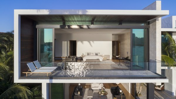 Modern home with outdoor, rooftop, and stone patio, porch, deck. Floor-to-ceiling pocketing sliding glass doors open up giving this master bedroom a one-of-a-kind view. A glass balcony allows for no visual obstructions. Photo 6 of Casa Ischia