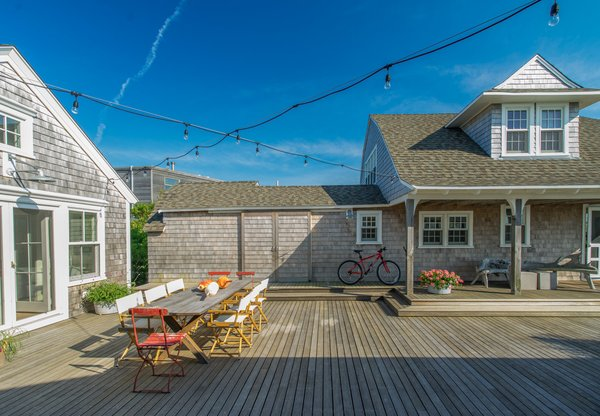 The west side of the courtyard opens magically to Cape Cod Bay and beyond. Photo 11 of Corkin House modern home