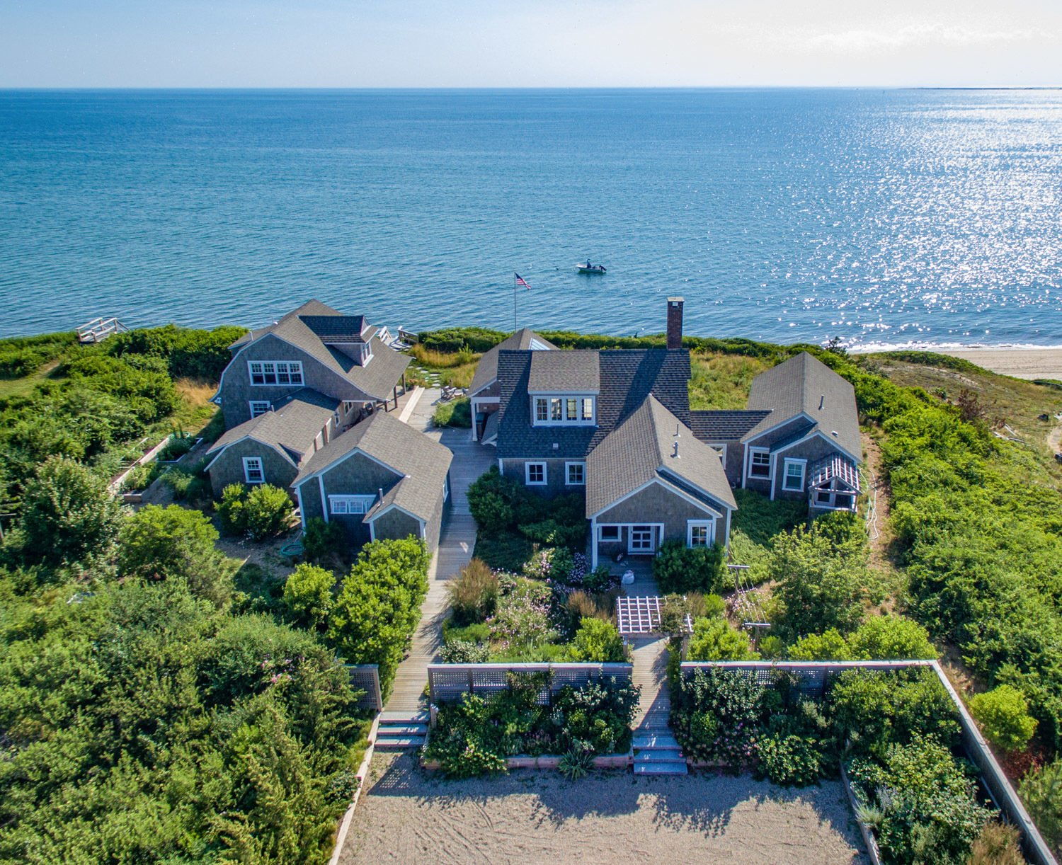 Aerial view of the compound overlooking Cape Cod Bay.  Corkin House by KRUEGER ASSOCIATES ARCHITECTS