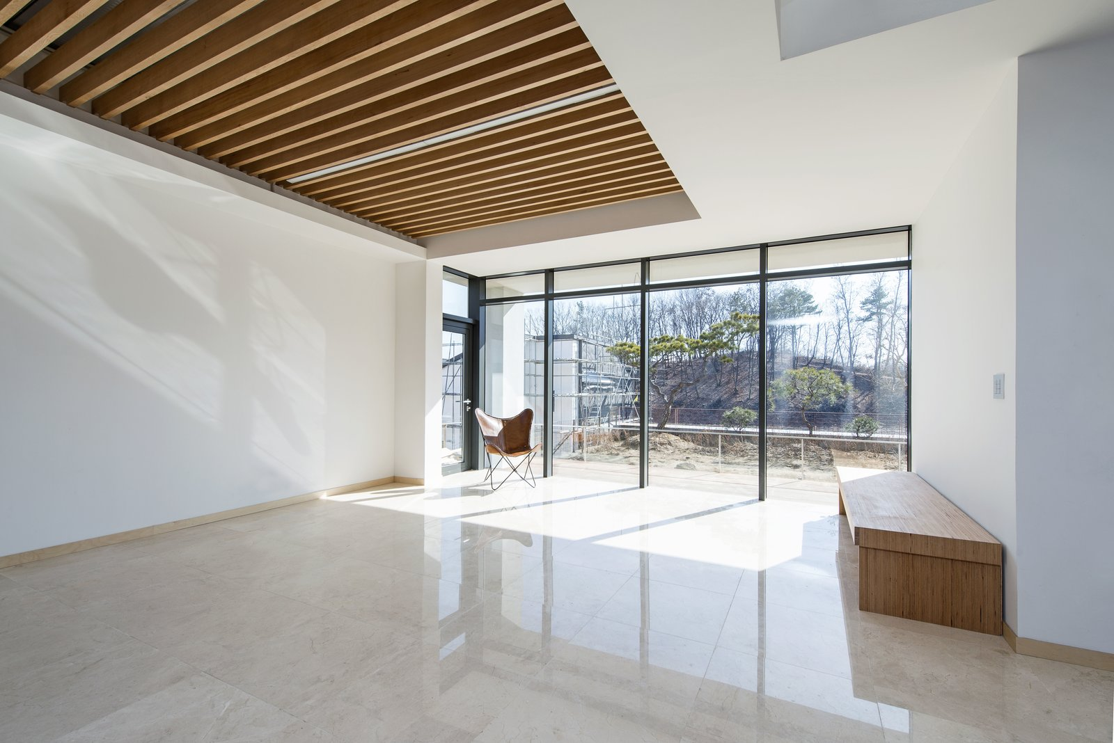 Living Room Tagged: Concrete Patio, Porch, Deck and Outdoor.  A House by Chang Kyu Lee